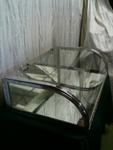 Chromed brass and curved glass flat display case