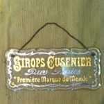 Vintage advertising glass plaque