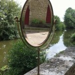 Vintage Siegel brass boutique mirror